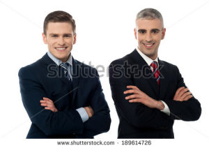 stock-photo-handsome-corporate-executives-posing-confidently-189614726